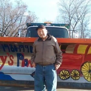 Resident Jerry in front of a snow plow near Jaybird Senior Living in Cedar Rapids, Iowa.