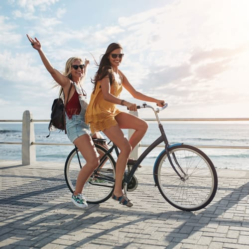 Girls enjoying a bike ride along the waterfront near The Columbia at the Waterfront in Vancouver, Washington