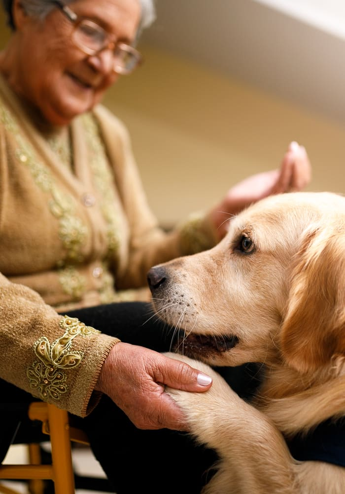 A resident with her dog at Cascade Valley Senior Living in Arlington, Washington