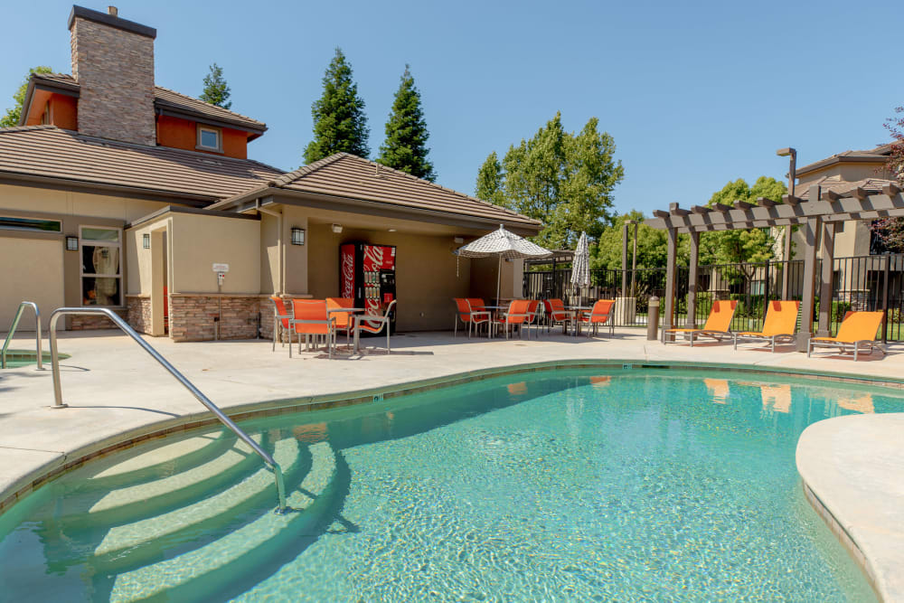 Sundeck with a umbrellas for shade at Wolf Ranch Condominium Rentals in Sacramento, California