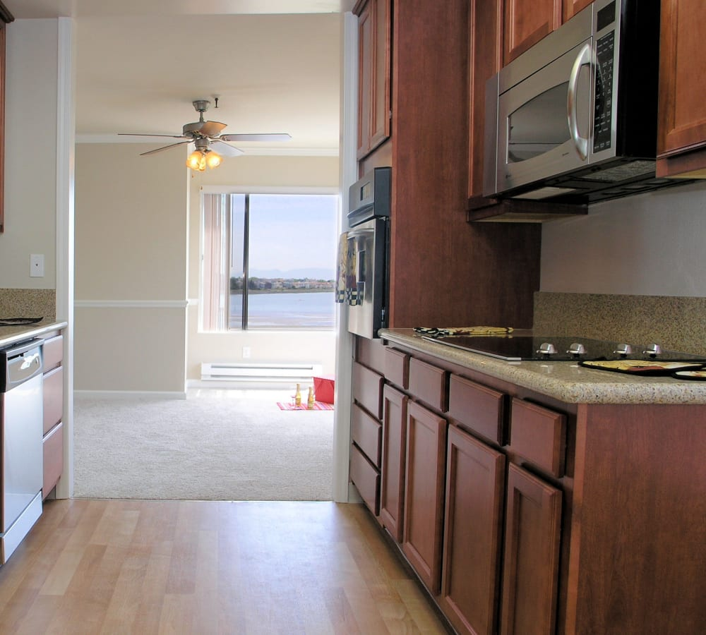 Kitchen with stainless-steel appliances at Tower Apartment Homes in Alameda, California