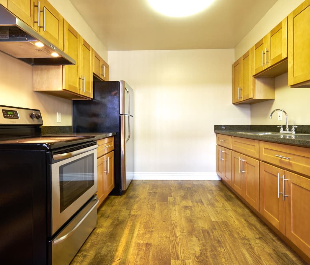 Kitchen with stainless-steel appliances at Palms at the Pruneyard in Campbell, California