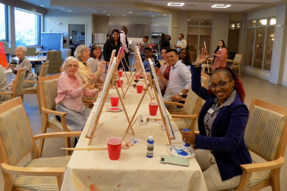 Residents enjoying paint and sip night together