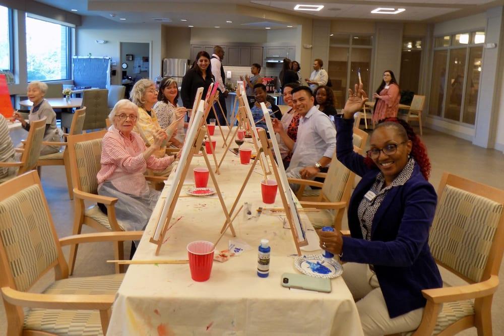 Residents enjoying a painting event at Merrill Gardens at Rockridge in Oakland, California.
