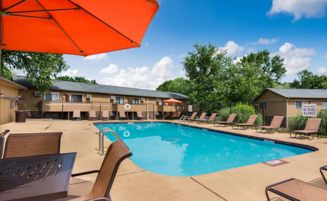 Swimming pool with a sundeck and lounge chairs at 1022 West Apartment Homes in Gaffney, South Carolina