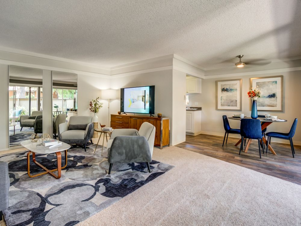 Spacious and modern open-concept floor plan with plush carpeting in a model home at Sofi Fremont in Fremont, California