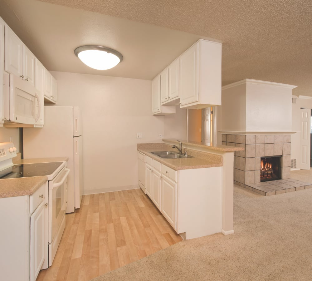 Spacious kitchen with large white cabinets at La Valencia Apartment Homes in Campbell, California