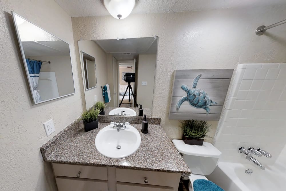 Bright bathroom at Falls of Maplewood Apartments in Houston, Texas