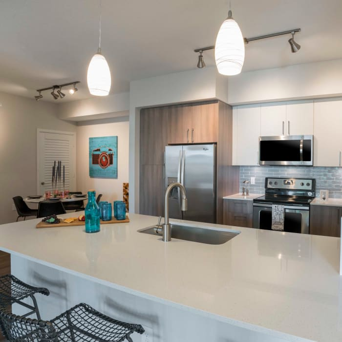 Open-concept model kitchen at Delray Station in Delray Beach, Florida