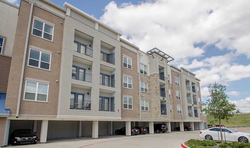 Spacious parking area at GreenVue Apartments in Richardson, Texas