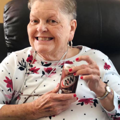Resident holding a soda at Oxford Glen Memory Care at Sachse in Sachse, Texas