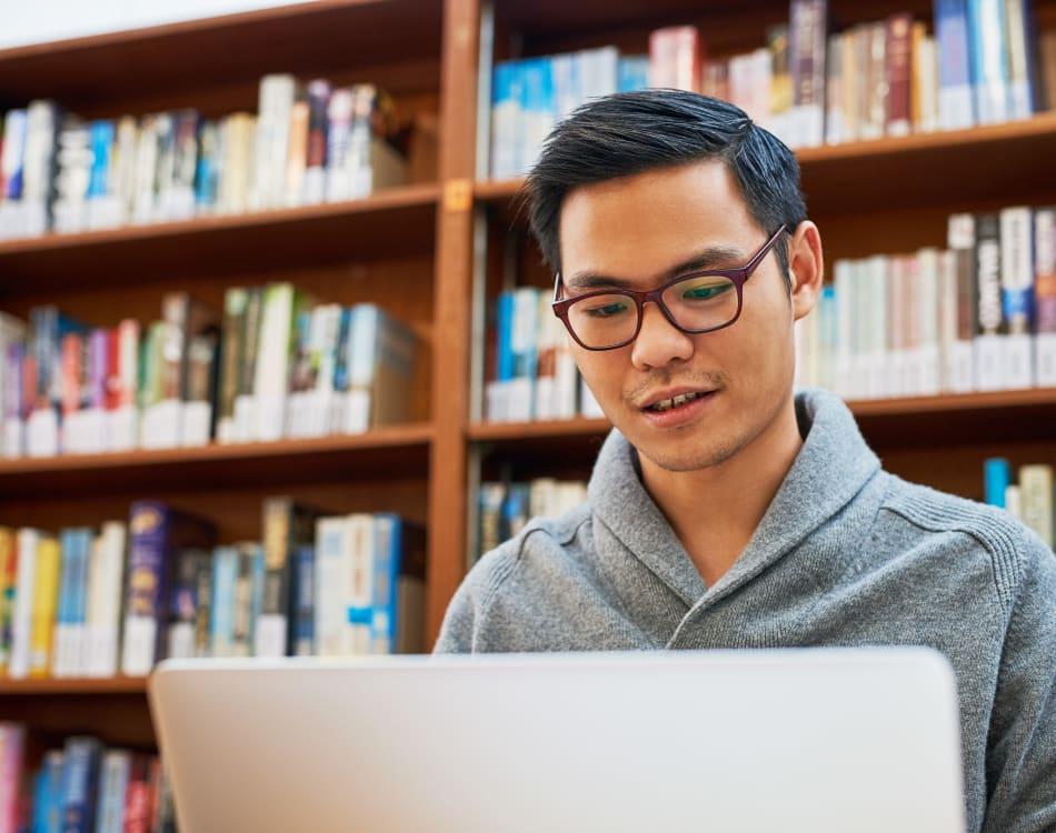 Resident student doing some homework on his laptop near Sofi Danvers in Danvers, Massachusetts