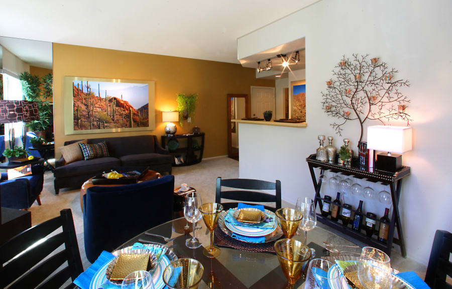 Dining table and living room at Sage Luxury Apartment Homes in Phoenix, Arizona