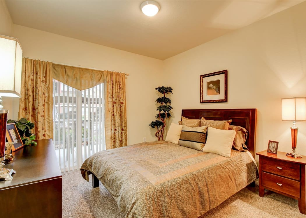 Well-decorated master bedroom at Brooks Landing in Modesto, CA