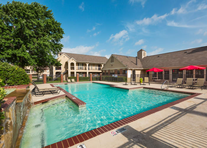 Beautiful swimming pool area at The Arbors of Carrollton in Carrollton, Texas