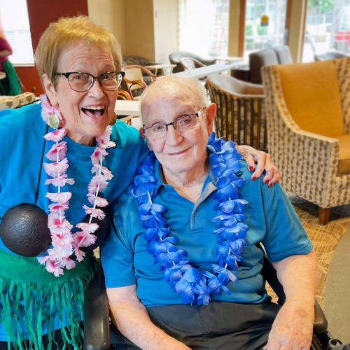 Resident couple showing off at The Oxford Grand Assisted Living & Memory Care in Wichita, Kansas