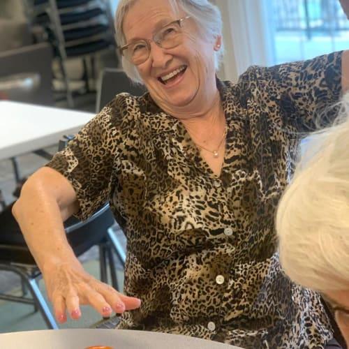 residents playing games at Oxford Villa Active Senior Apartments in Wichita, Kansas
