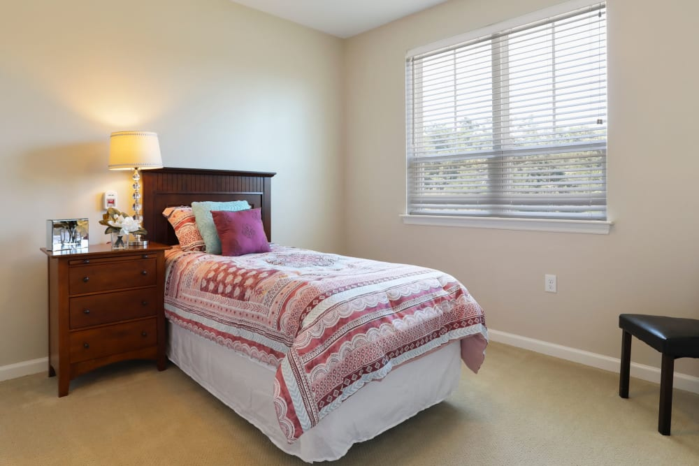 An apartment bedroom at Harmony at Martinsburg in Martinsburg, West Virginia