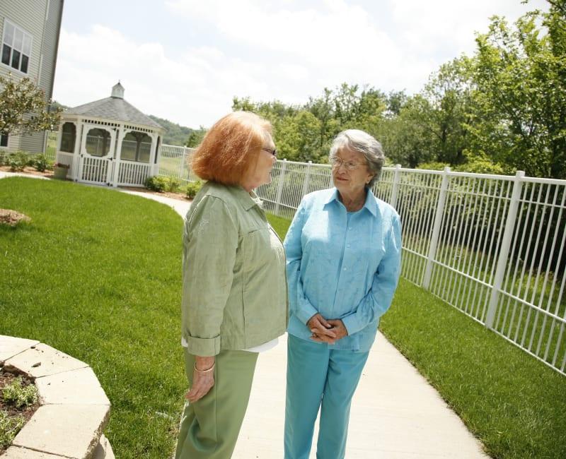 Residents by the gazebo at Deer Crest Senior Living in Red Wing, Minnesota