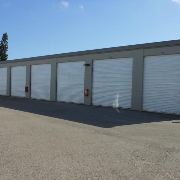 Outdoor storage units with white doors at StorQuest Self Storage in Venice, Florida