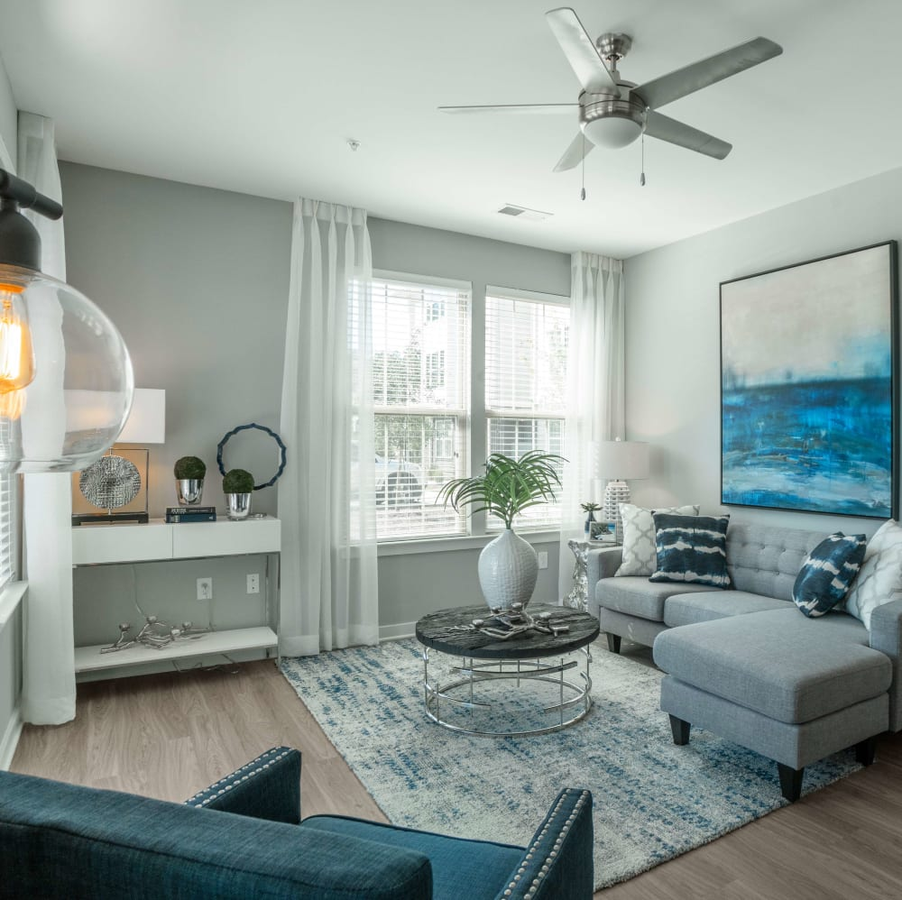 Open living room with a ceiling fan at Elevate at Brighton Park in Summerville, South Carolina