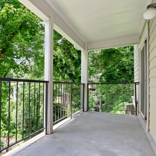 Private balcony with wooded views outside a model home at Crest at Riverside in Roswell, Georgia
