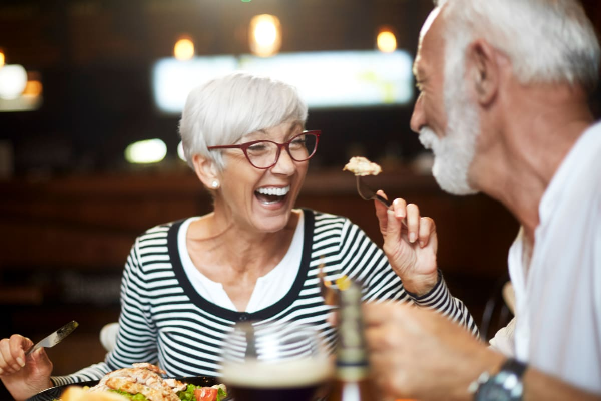 Couple having a fun dining experience together