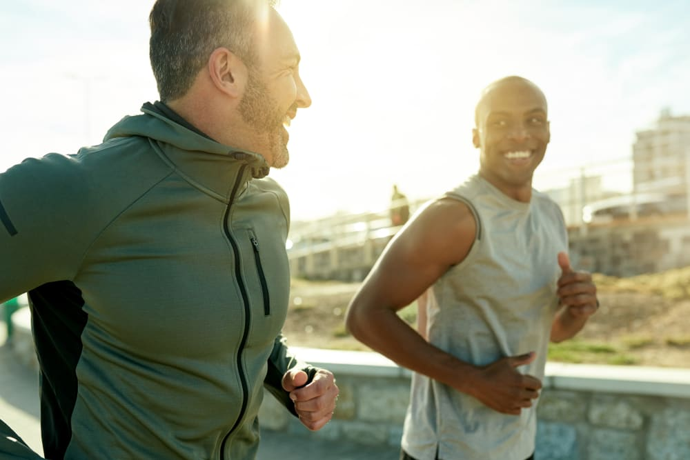 Two men on a jog near Riverstone Apartments in Bolingbrook, Illinois