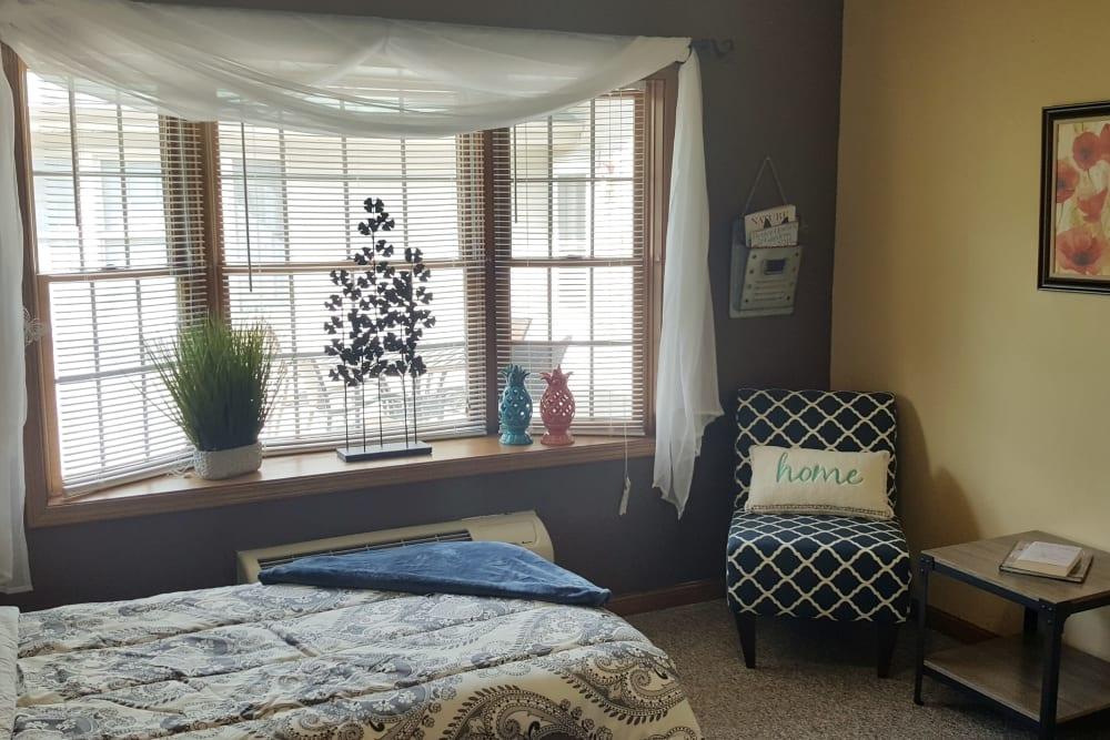 Calming bedroom of senior apartment at Brookstone Estates of Paris in Paris, Illinois