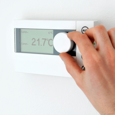 Adjusting a thermostat at A-American Self Storage in Honolulu, Hawaii