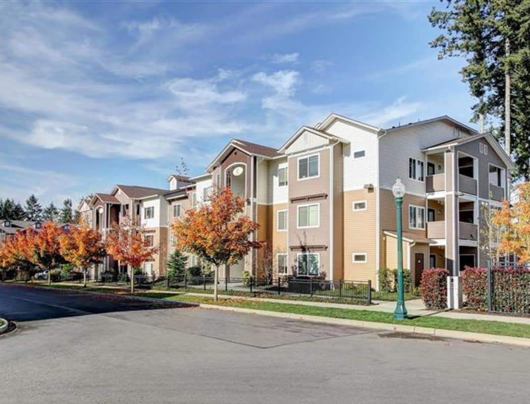 Resident buildings and neighborhood view at Woodland Apartments in Olympia, WA