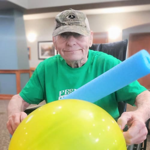 Resident playing games at Glen Carr House Memory Care in Derby, Kansas