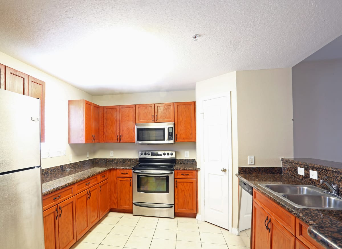 A spacious kitchen with plenty of countertop space at Town Park Villas in Tampa, Florida
