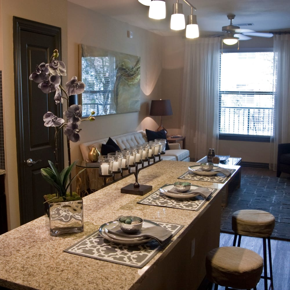 Large breakfast bar with granite counter tops at The Blvd in Irving, Texas