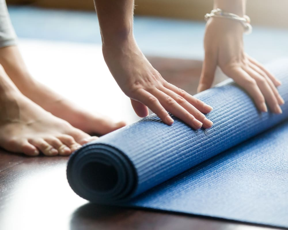 Rolling up the yoga matt after a fun class at The View on Pavey Square in Columbus, Ohio