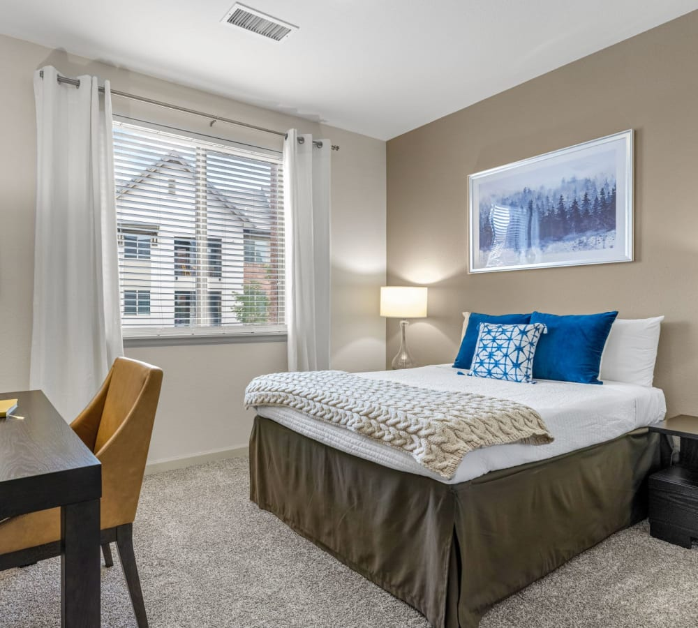 Spacious bedroom with a pool natural light from large window in an at The Parc at Greenwood Village in Greenwood Village, Colorado