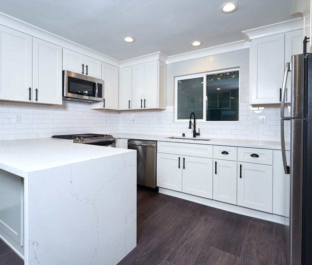 Modern kitchen with plenty of counter-space and wood-style flooring at Allure in Alamo, California