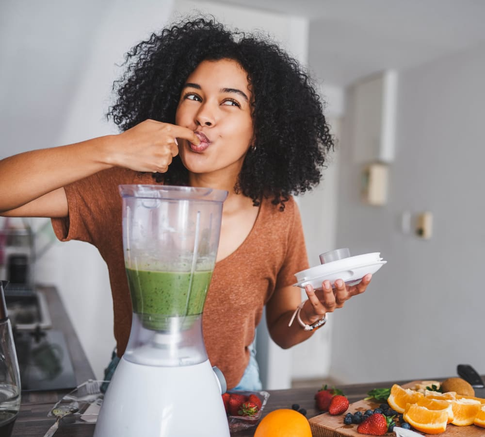 Woman tasting her smoothie at Alcott Place in Baltimore, Maryland