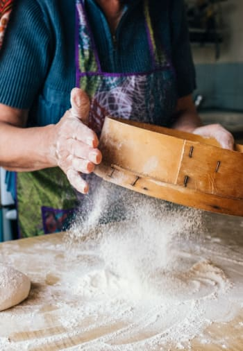 A baker making a dessert at The Claiborne at Thibodaux in Thibodaux, Louisiana