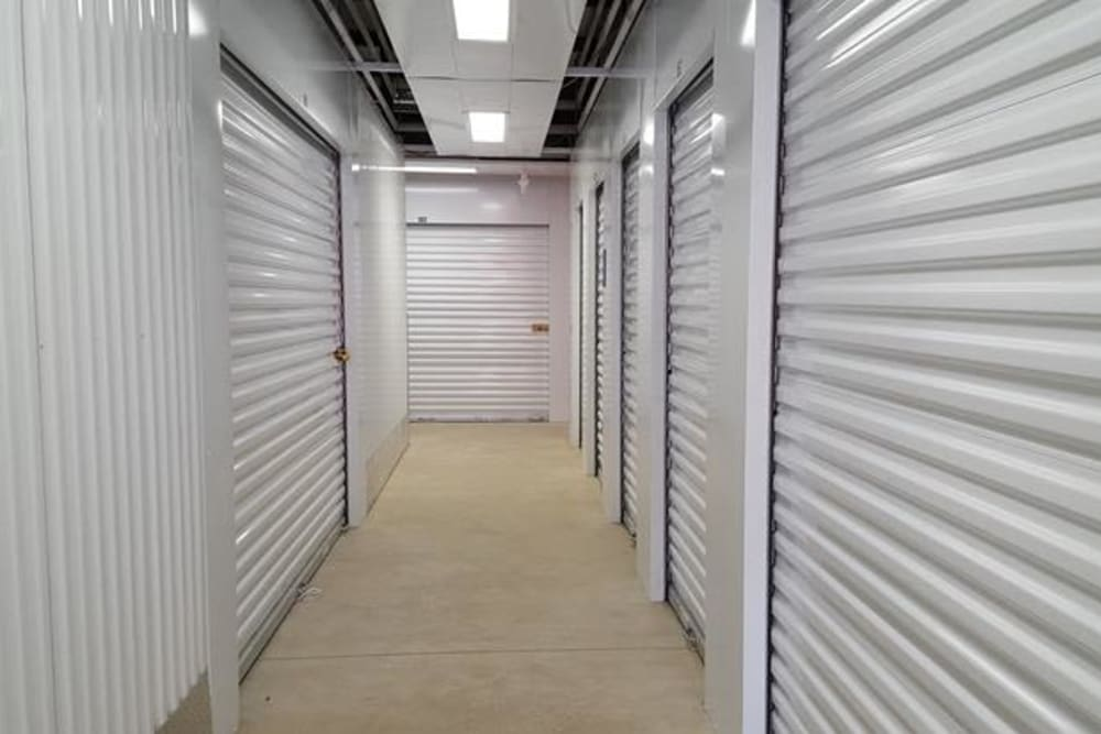 Hall of storage units at Monster Self Storage in Bonaire, Georgia