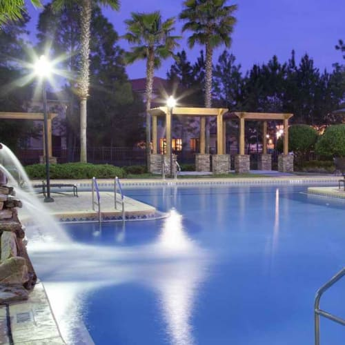 Dusk at the swimming pool area at Wimberly at Deerwood in Jacksonville, Florida