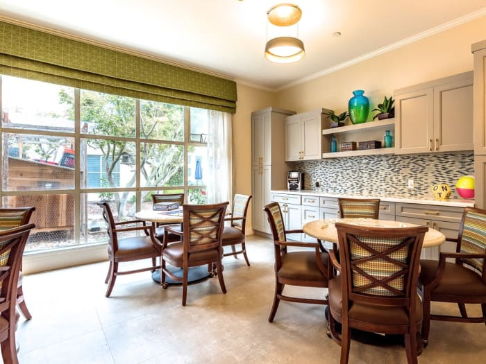 Beautiful dining room at Pacifica Senior Living Mission Villa in Daly City, California