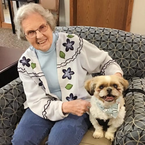A resident with her dog at Glen Carr House Memory Care in Derby, Kansas