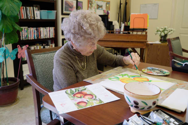 A resident at The Fair Oaks in Pasadena, California doing arts and crafts