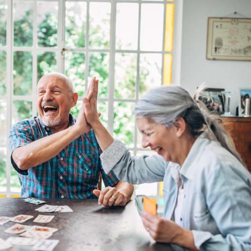 Residents enjoying a game at Truewood by Merrill, Oceanside in Oceanside, California.