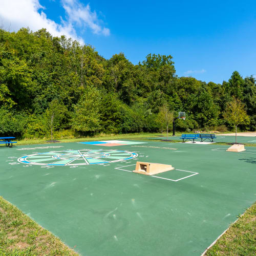 Sports court with basketball, corn hole, and other games at Indian Footprints Apartments in Harrison, Ohio