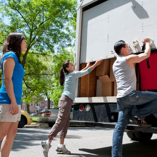 Family loading a moving truck for storage at Storage Units in Aiken, South Carolina