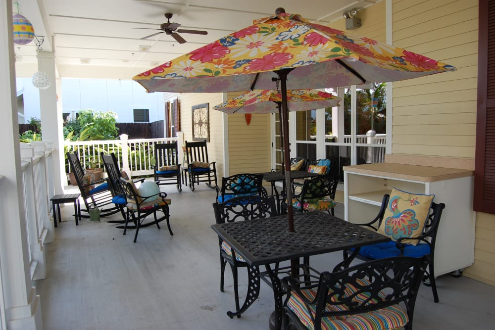 Covered patio seating at Autumn Grove Cottage at The Heights in Houston, Texas