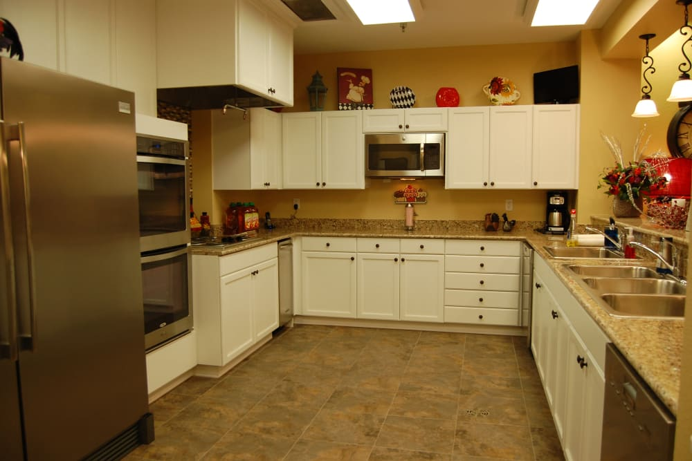 A well equipped community kitchen at Autumn Grove Cottage at The Heights in Houston, Texas