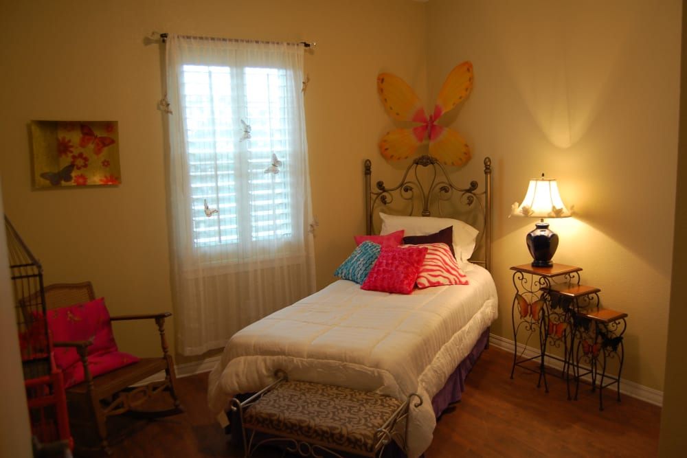 A butterfly themed bedroom at Autumn Grove Cottage at Champions in Spring, Texas